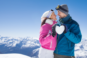 happy couple in the snowy mountains